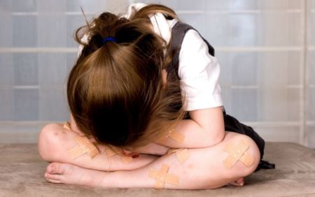 Concept of a young injured girl being a victim of child abuse